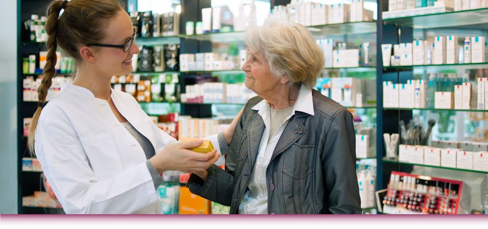 pharmacist going over medication to woman